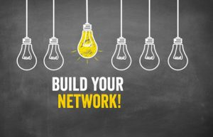 light bulbs with words build your network
